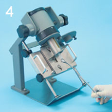 PET Dose Drawing System Syringe Shield slides upward, allowing the syringe to puncture the vial septum. Dose is drawn.